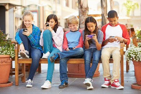 Group Of Kids Using Cell Phones